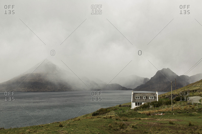 Cloudy weather covers the shoreline near the Cuillin Mountains on the Isle of Skye, Scotland
