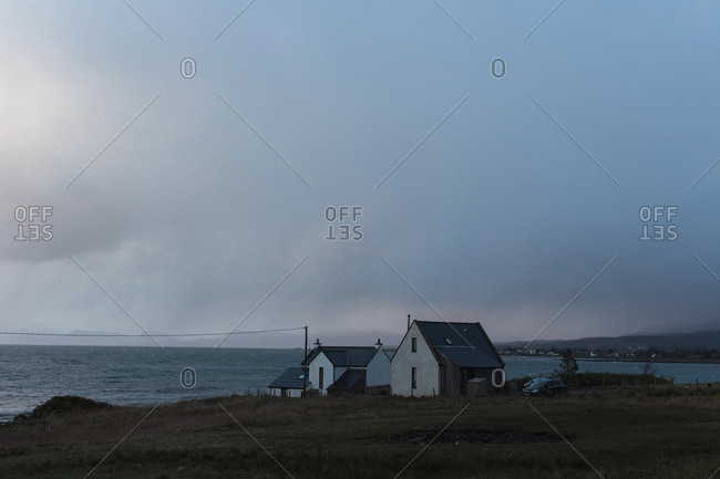 A small farmhouse on the edge of the ocean in rural Scotland