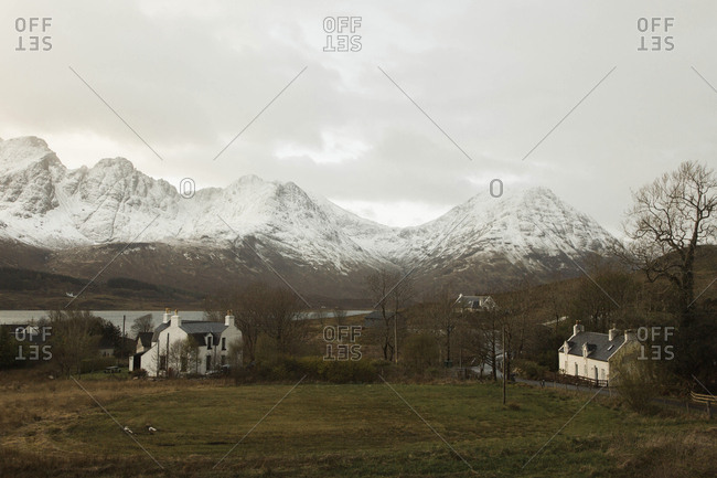 The snow capped Cuillin Mountains on the Isle of Skye during a cloudy evening in Scotland