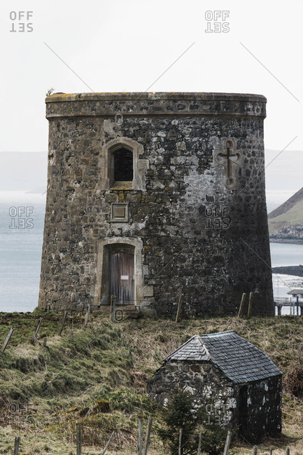 An old piece of a castle overlooking the water on the northern edge of the Isle of Skye, Scotland