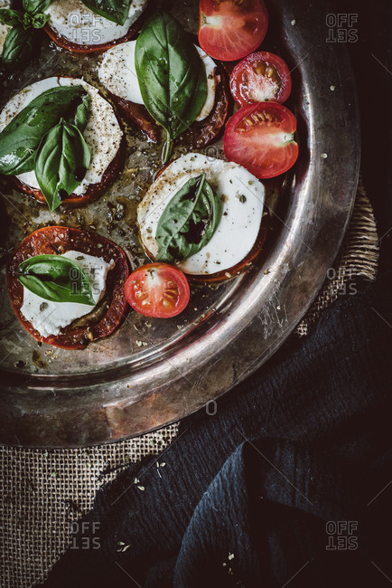 Overhead view of roasted tomato caprese salad