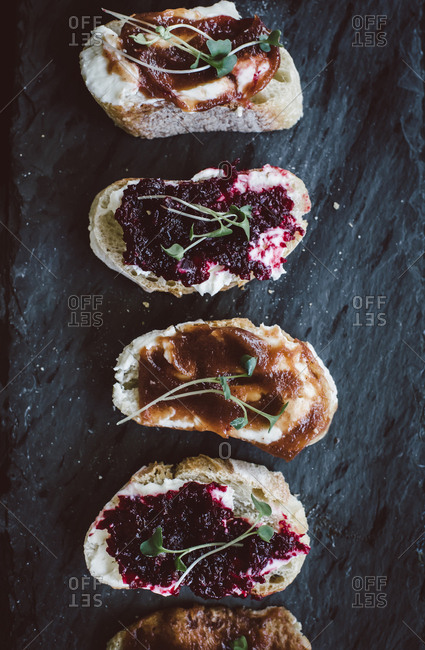 Bread slices topped with various jams and spreads