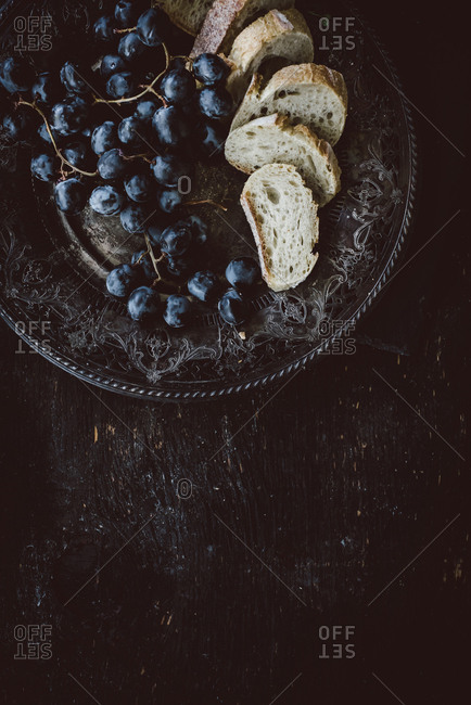 Grapes and bread on a serving platter