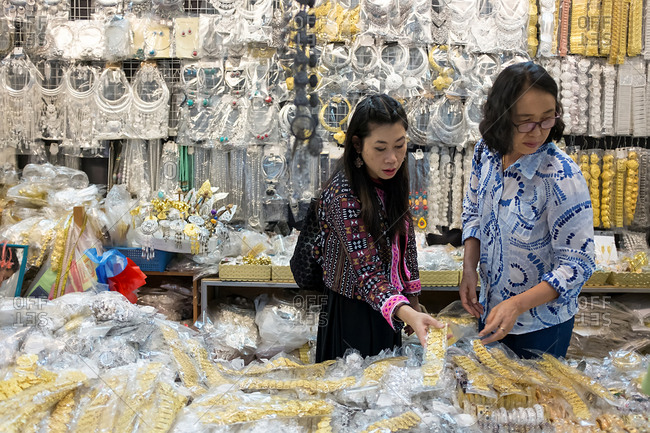 Chiang Mai, Thailand - December 3, 2017: Women shopping for jewelry at a market