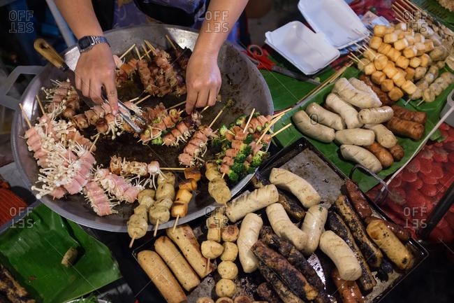 Person preparing Thai street food