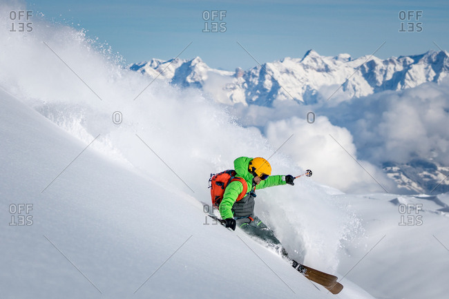 A male skier skiing in powder snow at the Kitzsteinhorn Glacier near Salzburg in Austria