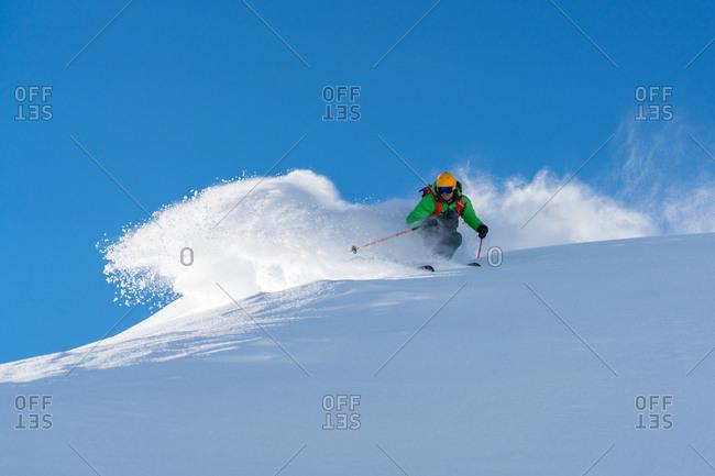 A male skier skiing in powder snow at the Kitzsteinhorn Glacier near Salzburg in Austria