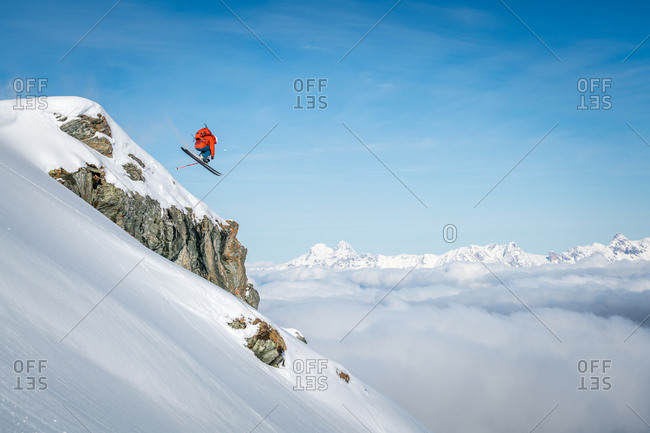 A male skier makes a jump in fresh powder snow at the Kitzsteinhorn Glacier near Salzburg in Austria