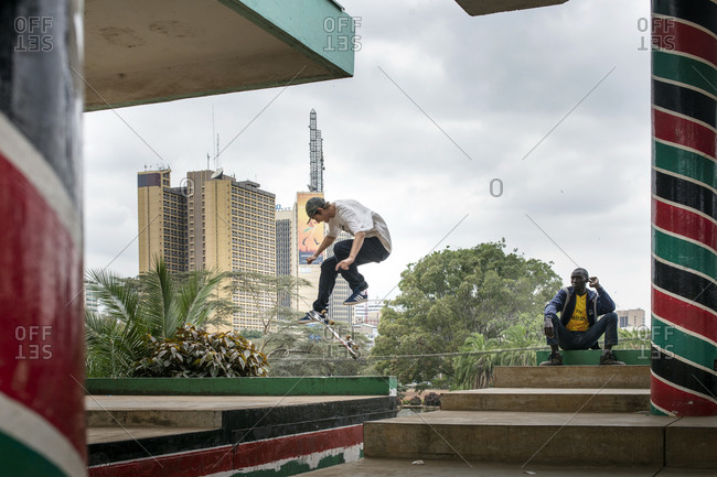 Nairobi, Kenya - July 5, 2017: A skateboarder in mid flight performing a trick in an urban area of Nairobi