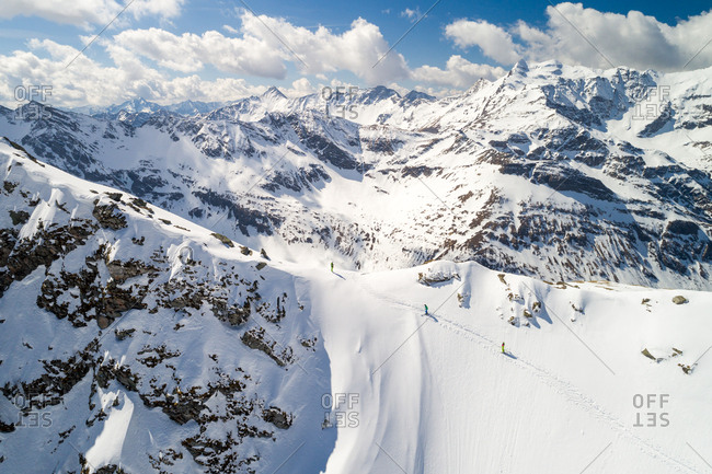 Aerial view of a group of 3 people ski touring in the Sportgastein ski area in Austria