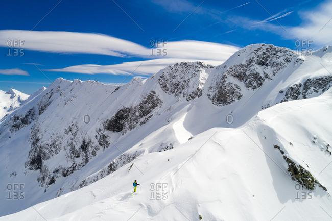 Free ride skier is enjoying the beautiful mountain landscape in the Sportgastein ski area in Austria