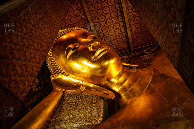 Bangkok, Thailand - July 9, 2017: The big reclining Buddha statue at the Wat Pho Buddhist Temple complex, which is popular tourist destination next to the Grand Palace