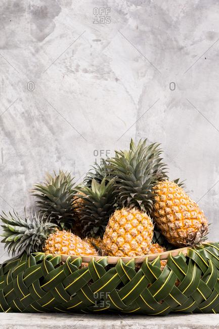 Pineapple arranged in a canoe basket