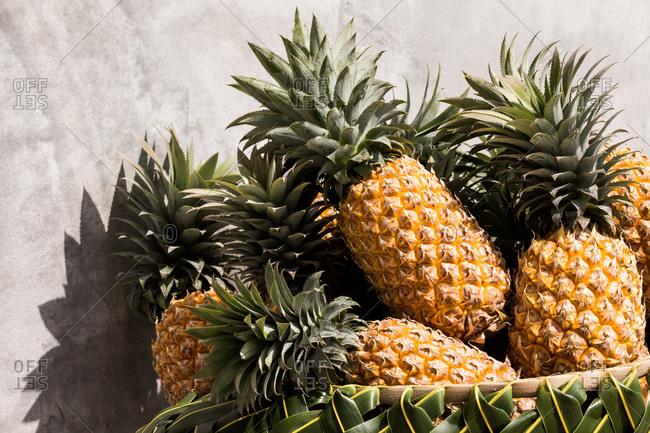 Pineapple arranged in a market basket