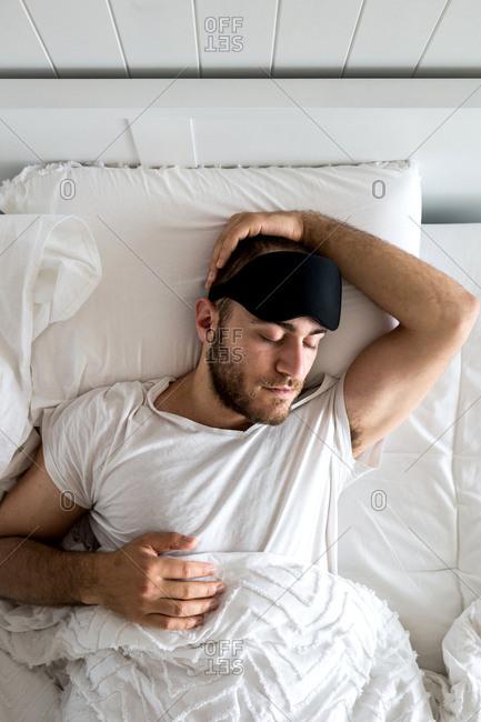 Sleeping man with eye mask