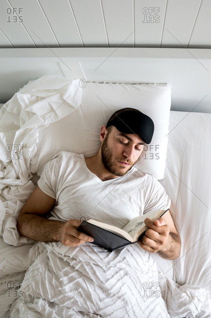 Man reads in bed