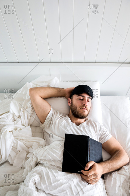 Man sleeping with open book