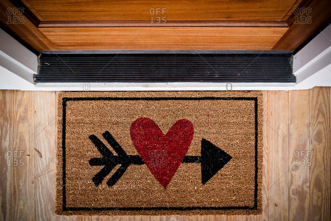 Door mat with heart and cupid's arrow motif