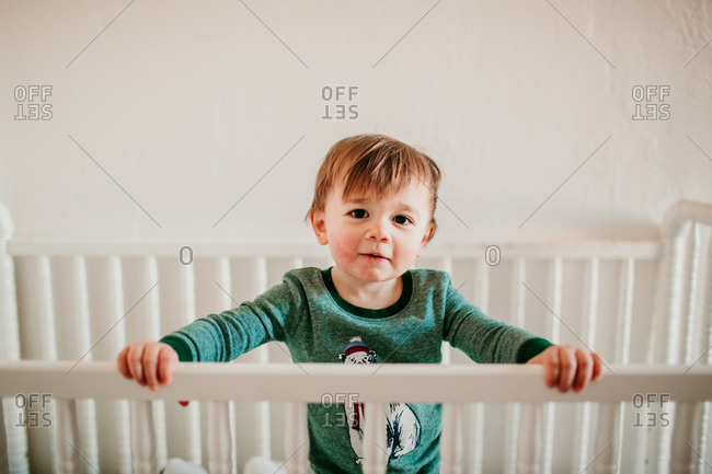 Baby standing in his crib after waking up