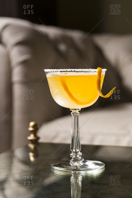 Sidecar cocktail on a glass top table