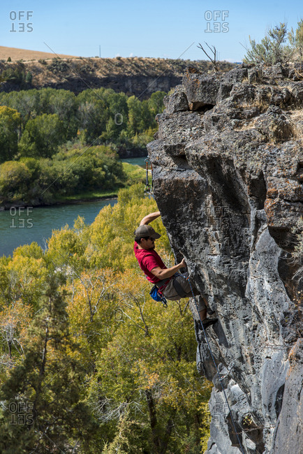 Driggs, Idaho - September 26, 2017: High angle view of man climbing on rock against clear sky