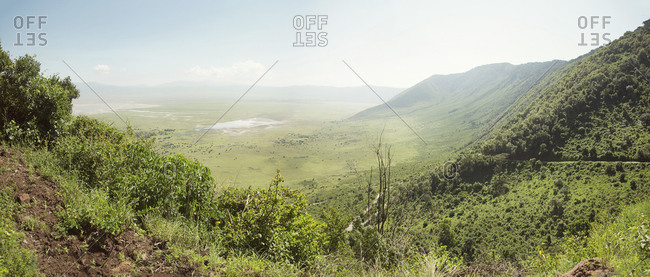 Panoramic view of mountains by field