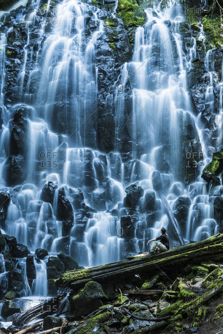 Man sitting against of Ramona Falls at Mt hood