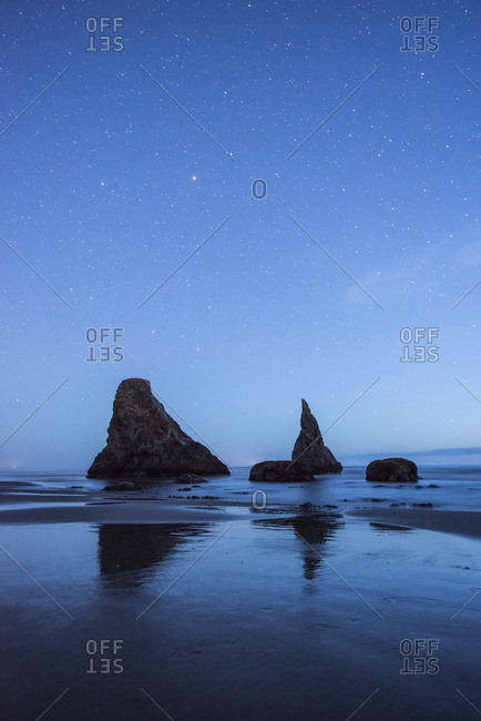 Scenic view of sea against blue sky at night