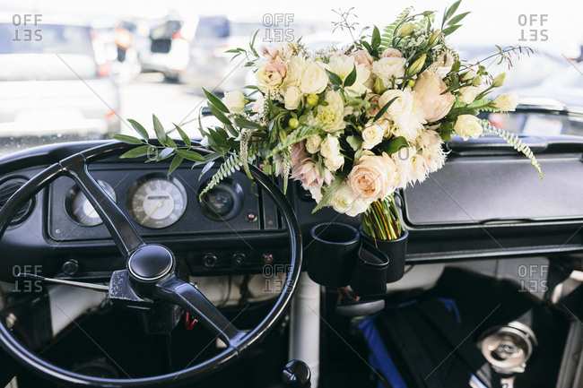 High angle view of bouquet on dashboard in car