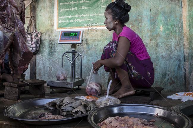 Bagan, Myanmar - September 28, 2016: Butcher at Nyaung U market