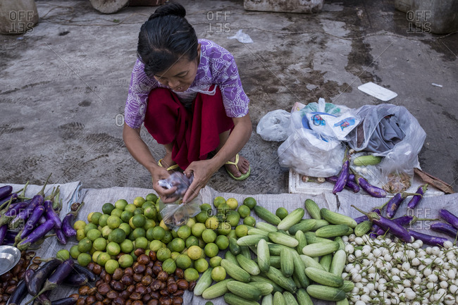 Yangon, Myanmar - September 29, 2016: Selling vegetables at a street market in downtown Yangon