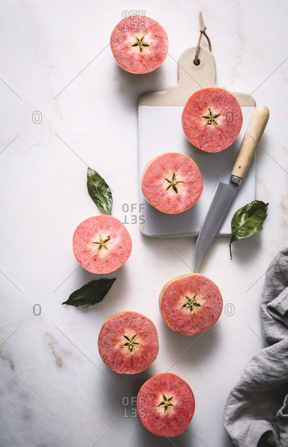 Pink apples sliced in half
