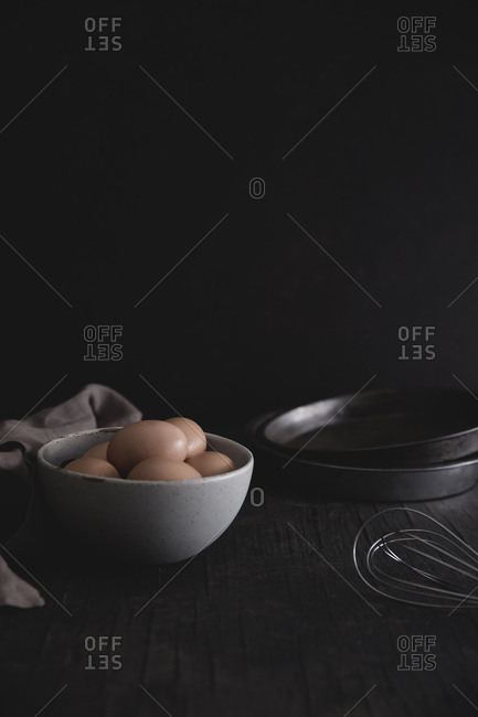 Still life of eggs and baking pans
