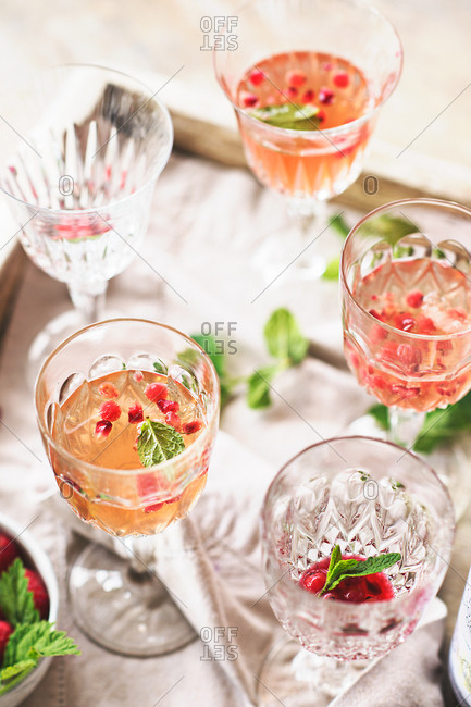 Holiday cocktails with berries and mint
