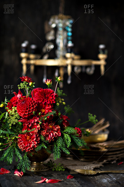 Red dahlia arrangement on a wooden table