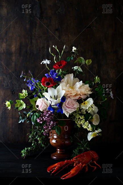 Colorful floral arrangement and a lobster