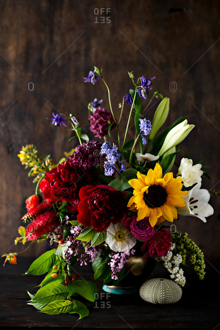 Brightly colored floral arrangement on a wooden table