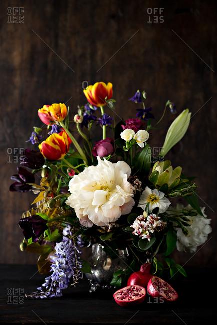 Colorful floral arrangement and pomegranates