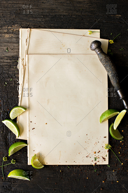 Bank paper and vintage pen with limes on wooden table