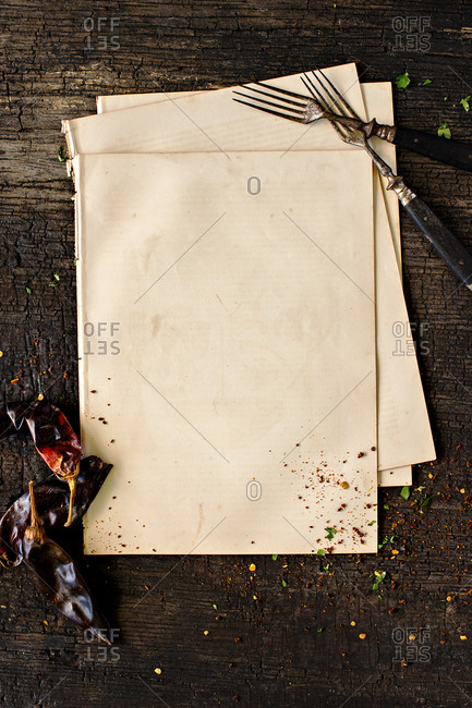 Bank paper and vintage forks with dried peppers on wooden table