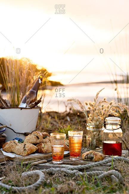 Sunset picnic overlooking lake