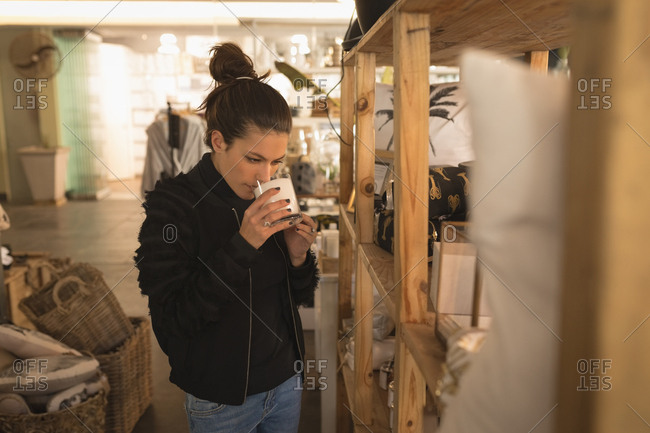 Beautiful woman drinking milk in coffee shop