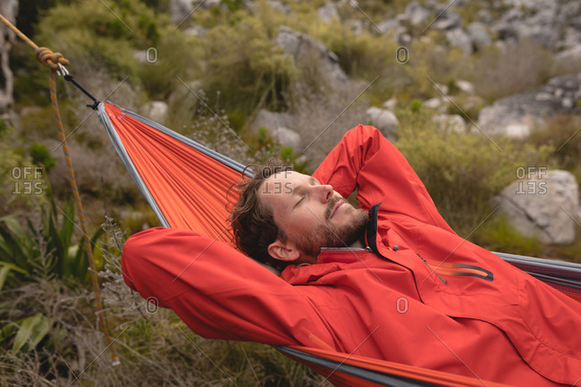 Close-up of hiker relaxing in hammock on a sunny day