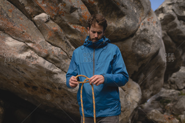 Determine hiker folding climbing rope