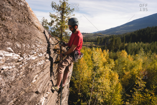 Determined rock climber climbing the rocky mountain