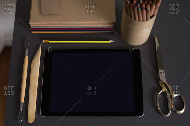 High angle vie of digital tablet and stationery on table