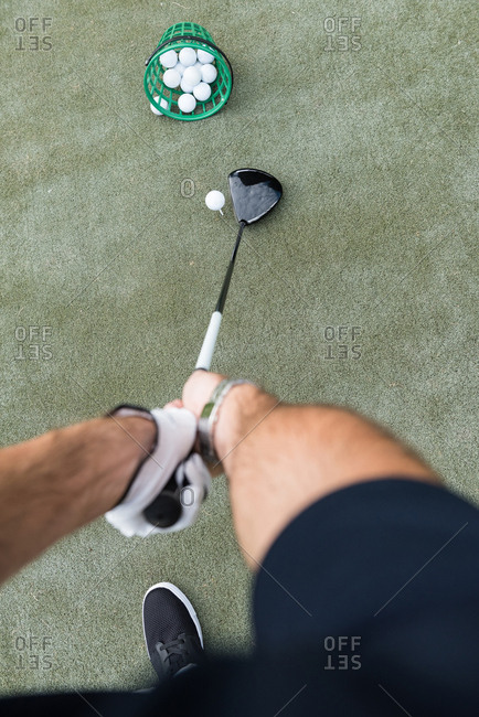 High angle view of golfer hitting a golf shot in the golf course