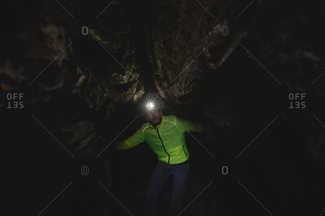 Hiker exploring the dark cave