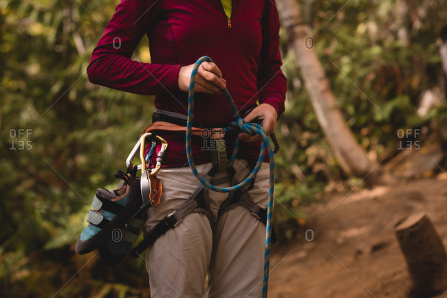 Mid section of female hiker preparing herself to climb the rocky mountain