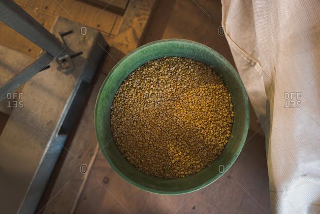 Overhead of refined wheat in bucket